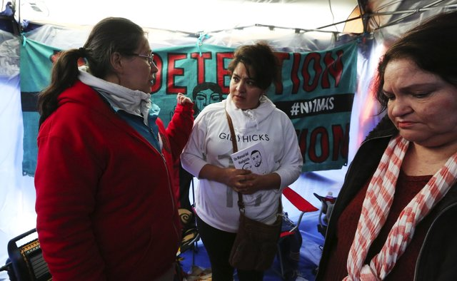Maru Mora Villalpando, left, organizer of the encampment, talks with supporters Nestora Salgado and Eva Chavez Thursday, April 13, as the hunger strike continues inside the Northwest Detention Center in Tacoma.
